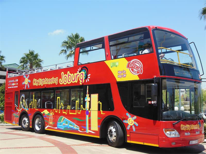 TAKE A TOUR. Hop on and hop off the red open top double decker Red City buses.