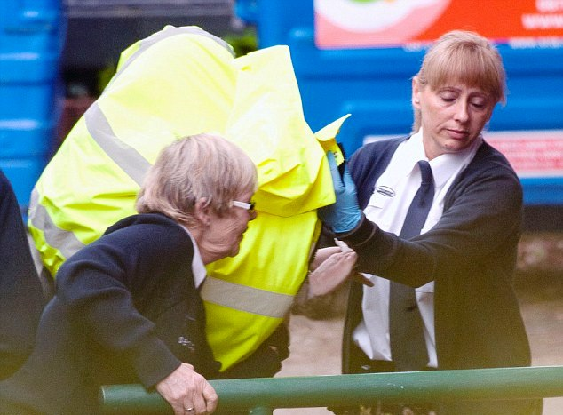 Tania Clarence being led into Wimbledon Magistrates court under a coat earlier this year. Pic: Daily Mail