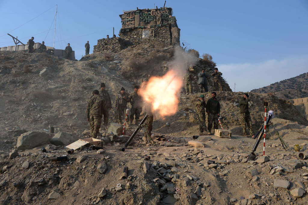 In this file picture taken on January 3, 2015, Afghan National Army (ANA) soldiers fire a 120mm mortar round during an ongoing anti-Taliban operation in Dangam district near the Pakistan-Afghanistan border in the eastern Kunar province. Afghan security forces have launched a joint anti-militant operations in several parts of Dangam district of Kunar province. So far in the operation, 157 armed insurgents have been killed and 112 others wounded, seven security personnel killed and six others were wounded in the past 25 days, police chief Abdul Habib SyedKhalil said. AFP PHOTO / Noorullah Shirzada