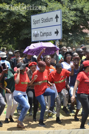 Students and members of the EFF sing struggle songs, 30 January 2015, at the Vaal University of Technology in VanderbijlPark. Students are calling for the National Student Financial Aid Scheme (NSFAS) to pay out money to those students who are in financial trouble. Picture: Alaister Russell