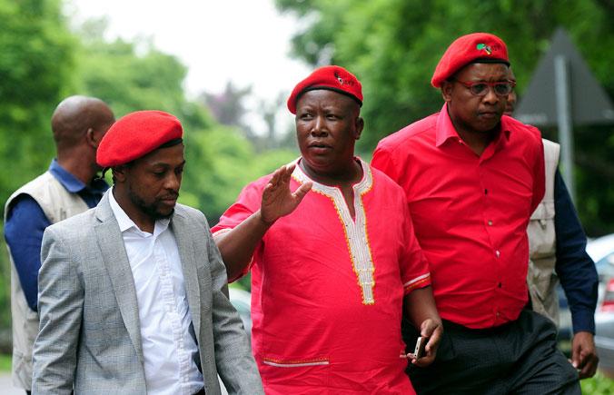 EFF National spokesperson Mbuyiseni Ndlozi (left),  EFF leader Julius Malema (centre), and EFF National Chairperson Dali Mpofu. Picture: Nigel Sibanda