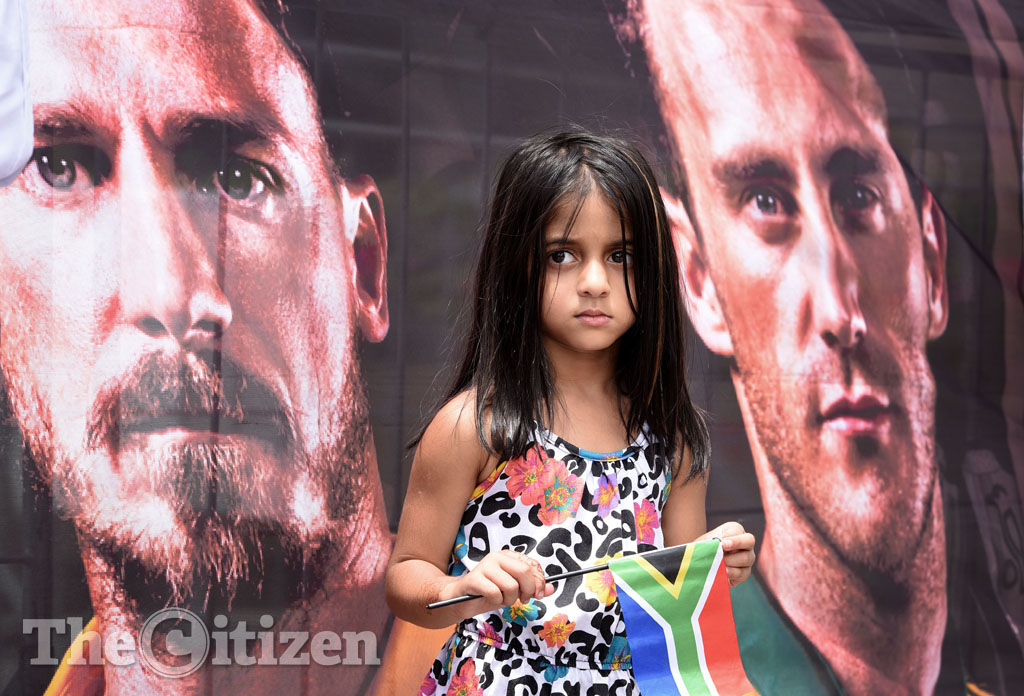 Five year old Imaan Theba stands infront of a South African cricket banner during the Proteas send-off in Johannesburg, 04 February 2015, ahead of the 2015 ICC Cricket World Cup in Australia and New Zealand. The event was attended by the minister of sport and recreation Fikile Mbalula and his deputy Gert Oosthuizen. Mbalula addressed the gathered crowd at Melrose Arch with an rousing message of support. Picture: Refilwe Modise