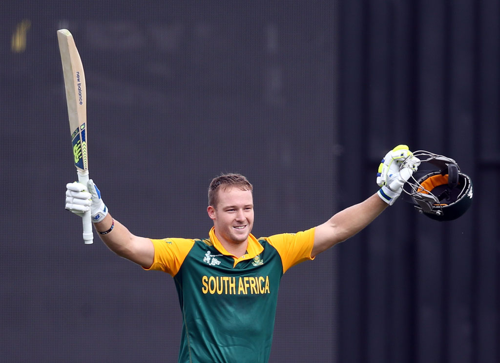 South Africa's David Miller celebrates his century during the Pool B 2015 Cricket World Cup match between South Africa and Zimbabwe at Seddon Park in Hamilton on February 15, 2015. AFP PHOTO / Michael Bradley