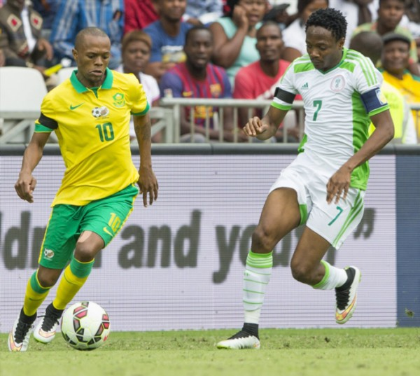 Thulani Serero of Bafana Bafana and Must Ahmed of Nigeria during the International Friendly match between South Africa and Nigeria at Mbombela Stadium on March 29, 2015 in Nelspruit, South Africa. (Photo by Dirk Kotze/Gallo Images)