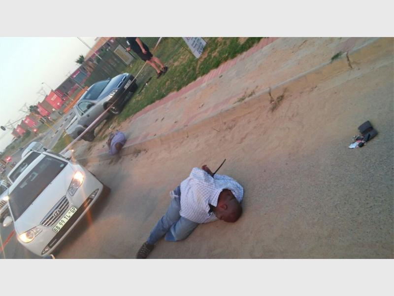 The suspects are pictured tied up and lying on the road. Pic: Rekord Centurion.