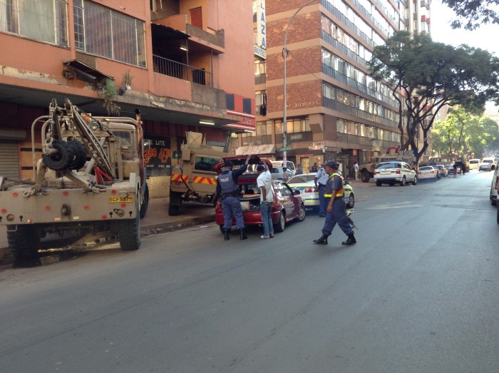 Police search a vehicle in Hillbrow Picture: Amanda Watson