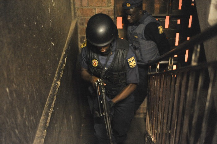 Police search the Madala hostel, 22 April 2015, in Alexandra Township, Johannesburg, during a full scale raid of the hostel. Picture: Alaister Russell