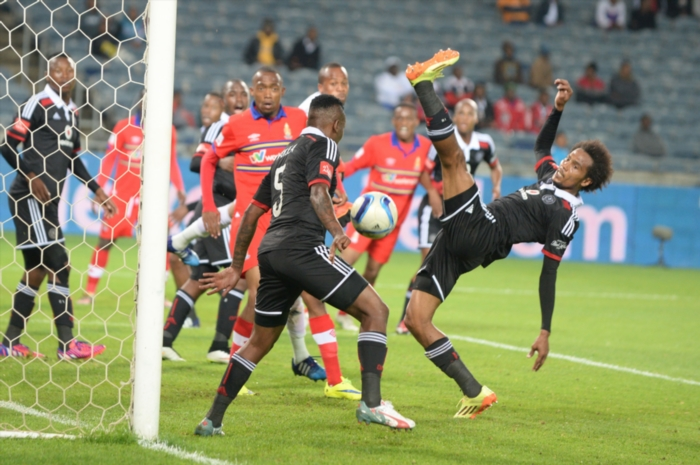 Issa Sarr and Tuks players during the Absa Premiership match between Orlando Pirates and University of Pretoria at Orlando Stadium on April 24, 2015 in Soweto, South Africa. (Photo by Lefty Shivambu/Gallo Images)