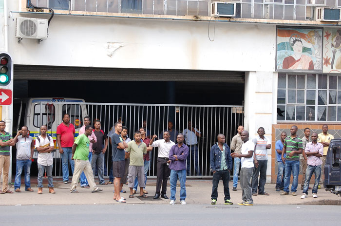 FILE PICTURE: A number of foreign nationals stand outside the police station on Yusuf Dadoo street [Broad street] as they seek protection from the attacks in the city of Durban. Picture: Phumlani Thabethe