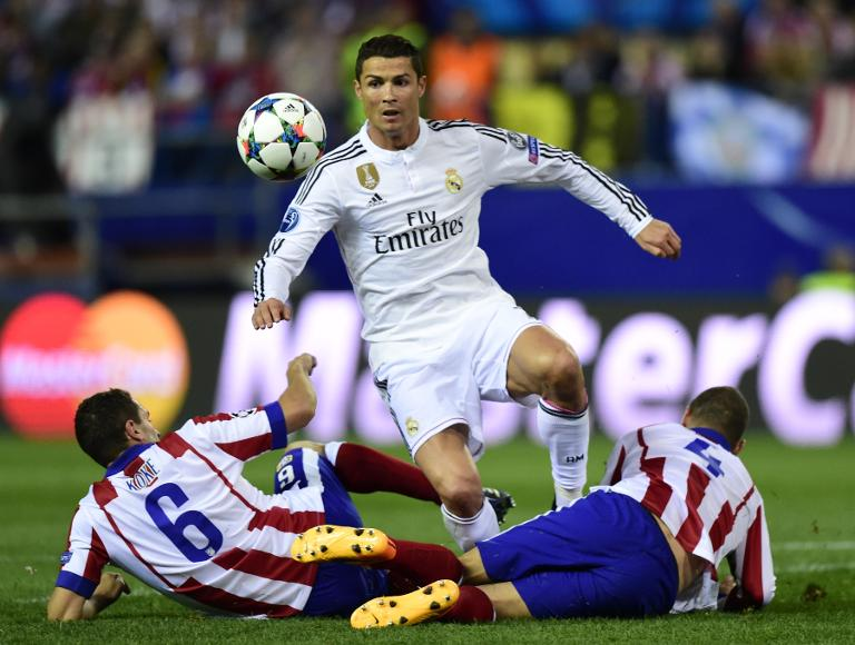 AFP / Javier Soriano<br />Real Madrid's forward Cristiano Ronaldo (C) vies with Atletico Madrid's midfielders Mario Suarez (R) and Koke during the UEFA Champions League quarter final first leg football match in Madrid on April 14, 2015