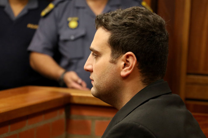 FILE PICTURE: Christopher Panayiotou stares straight ahead during his bail hearing application, 20 May 2015, at the Magistrates Court, Port Elizabeth. Picture: Judy de Vega