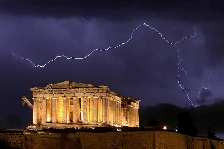 AFP/File / Aris Messinis<br />The ancient Greek Parthenon temple, atop the Acropolis hill overlooking Athens, is framed by a lightning bolt during a thunderstorm that broke out in the Greek capital in 2006