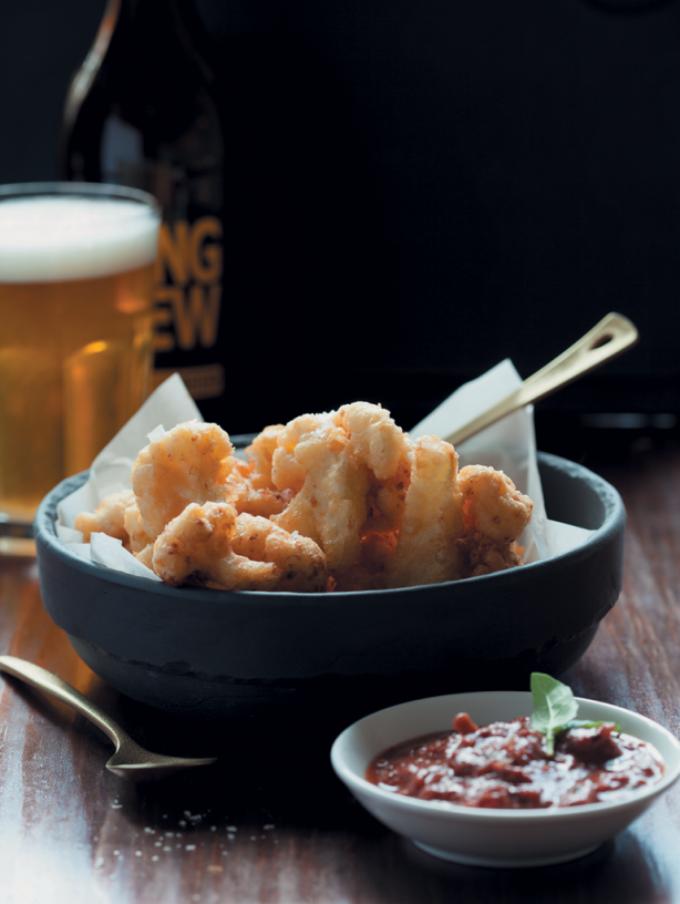 Beer-battered cauliflower with a spicy tomato and paprika sauce. Picture: Supplied