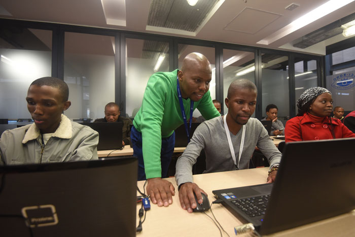MENTOR. Cojedi coordinator Khathu Mashau assists Tshepo Thabo with a module at the Sci-Bono Discovery Centre in Johannesburg. Pictures: Refilwe Modise