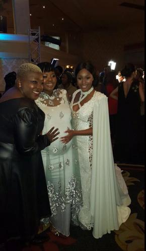 FAMILY. Minnie Dlamini rubs Anele Mdoda's tummy, who is pregnant. Picture: Twitter @MinnieDlamini