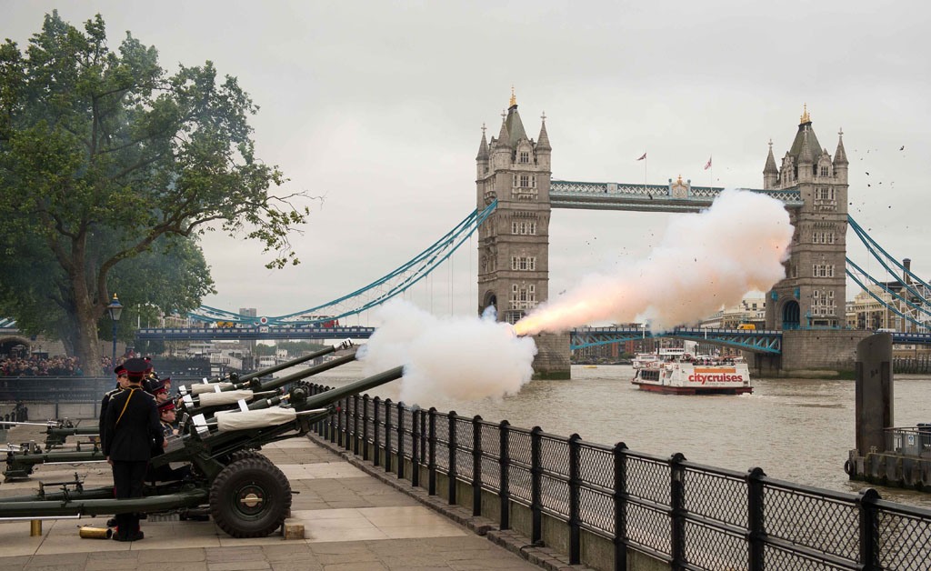 Members 2 Squadron HAC, Honourable Artillery Company (HAC), the City of London's Reserve Army Regiment, fire a 62 gun salute with L118 Ceremonial Light Guns from the Tower of London near Tower Bridge in London on June 2, 2015 to mark the 62nd anniversary of the coronation of Britain's Queen Elizabeth II. Picture: AFP