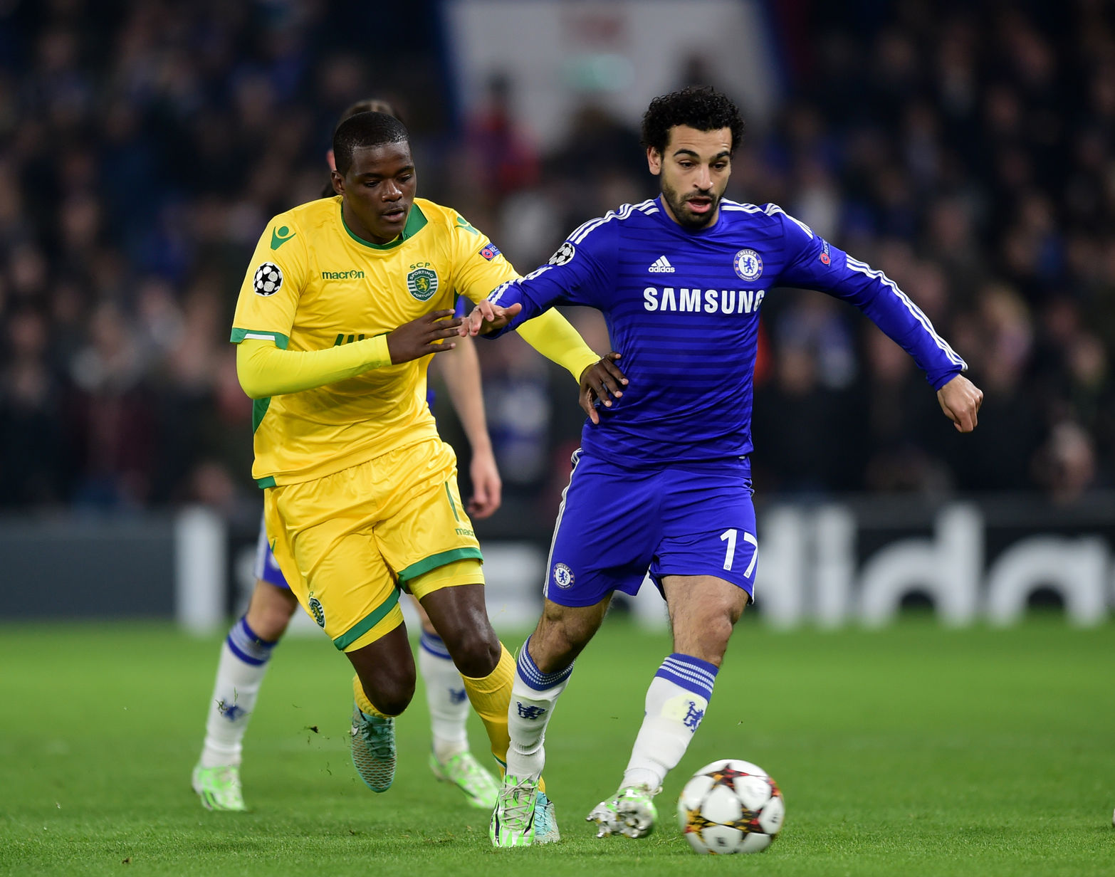 Sporting Lisbon's Silva William Carvalho (left) and Chelsea's Mohamed Salah battle for the ball during the UEFA Champions League Group G match at Stamford Bridge, London.