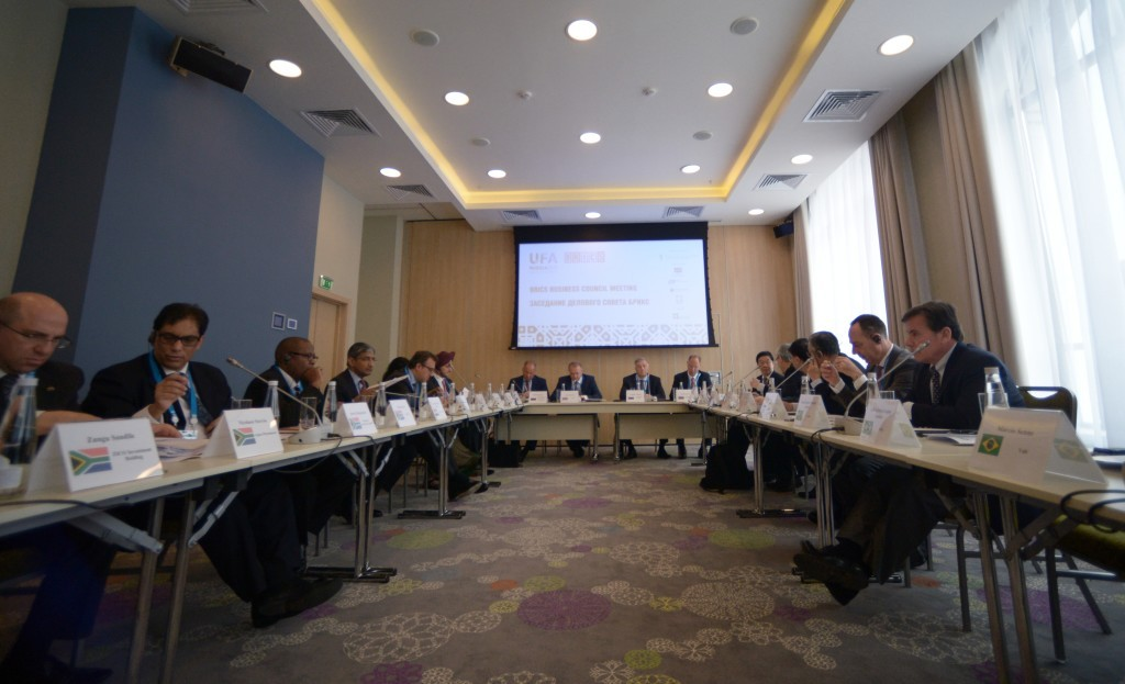 Dr Iqbal Surve, left, at a meeting of the BRICS Business Council in Russia. Host Photo Agency.