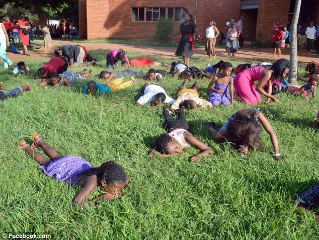 Congregants eating grass. Picture: Facebook