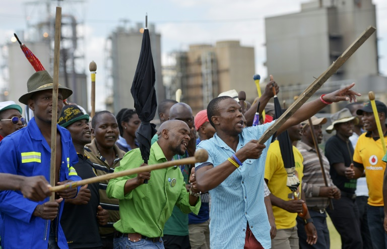 AFP/File / Alexander Joe<br />South African miners are pictured on a march near Lonmin's platinum mine in Marikana in January 2014 during a series of strikes by workers