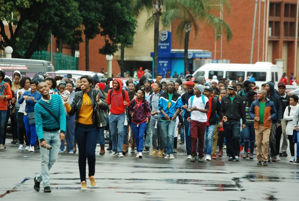 The Durban University of Technology students in the Durban campuses brave the rain as they walk while singing they were on a mission to chase out students from the classrooms, as they were starting a strike to show their dissatisfaction with the university and its management. Picture Phumlani Thabethe Date 22 July 2015