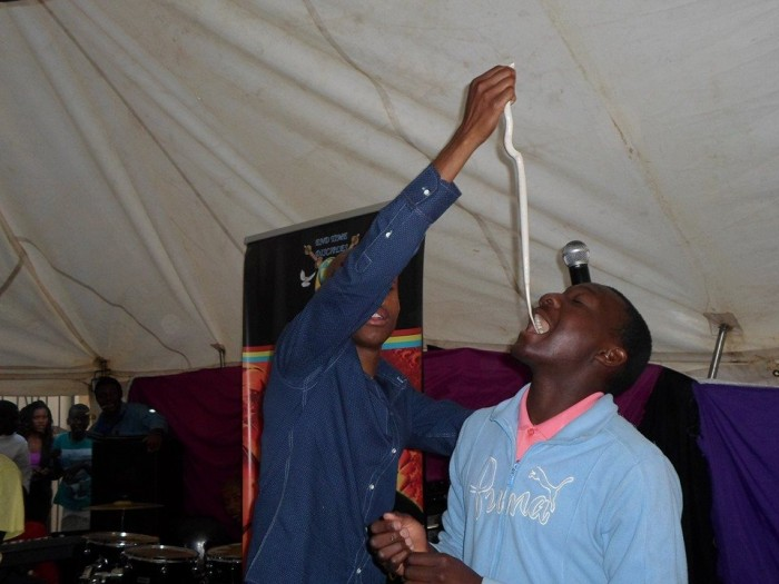 Pastor Mnguni makes his congregant eat a snake. Picture: Facebook