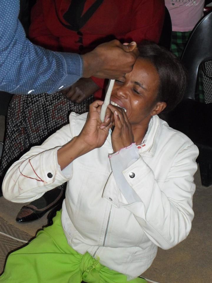 Pastor Mnguni makes his congregant eat a snake. Picture: Facebook