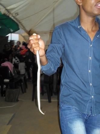 Pastor Mnguni makes his congregants eat a snake. Picture: Facebook