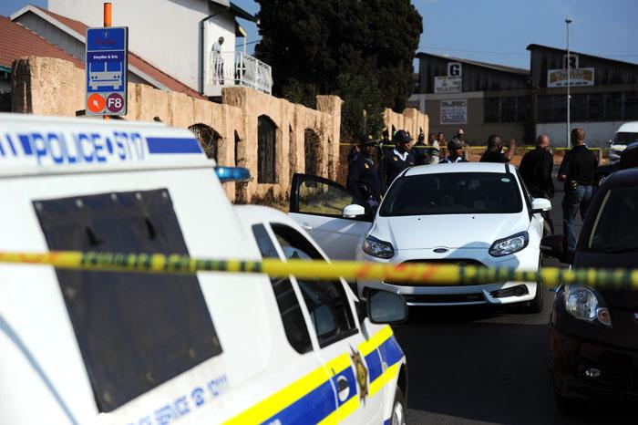 Police tend to a crime scene. Picture: Michel Bega