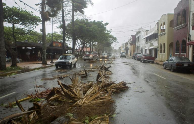 Storm kills 12 in Dominica, menaces Haiti