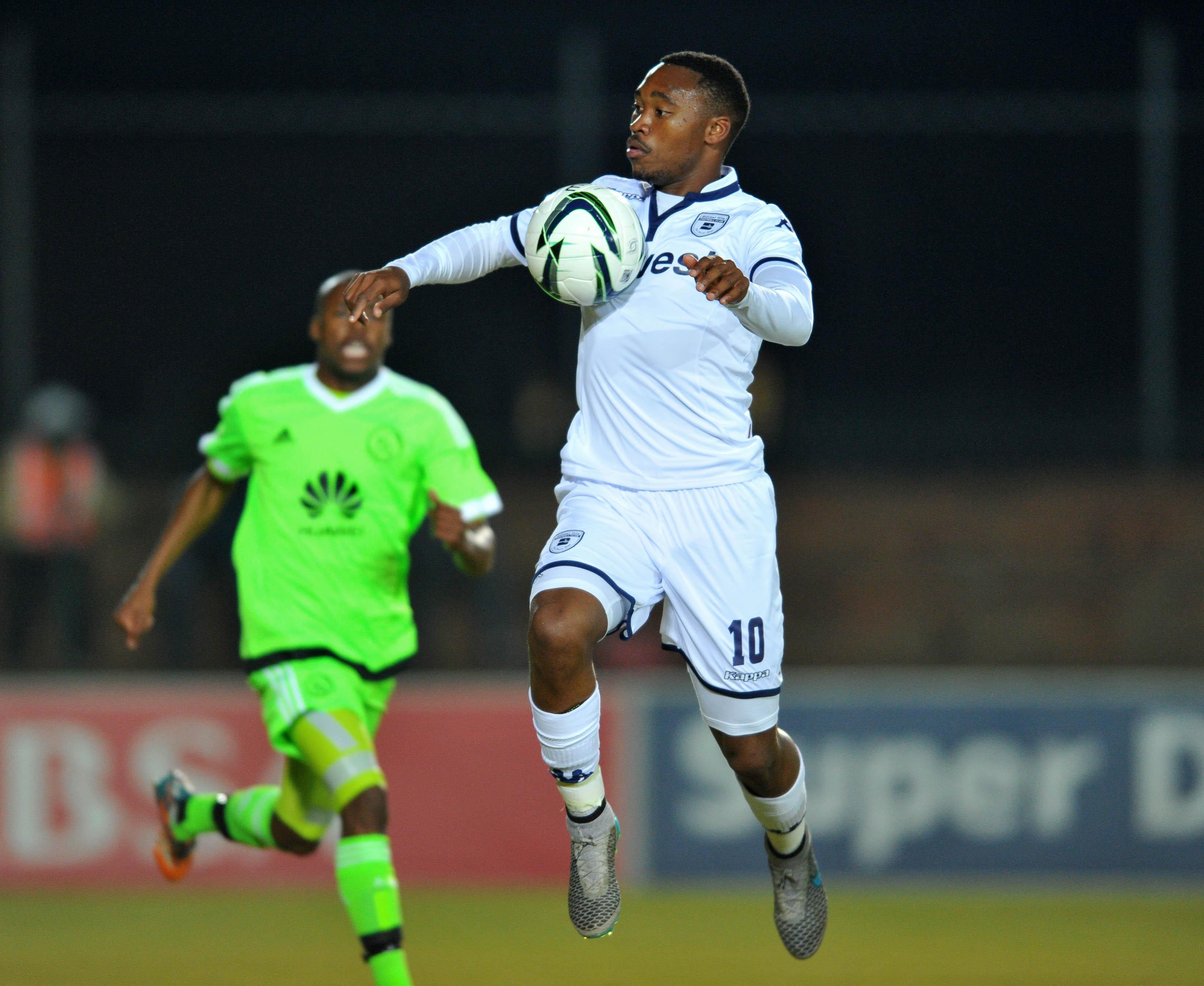 Sibusiso Vilakazi of Bidvest Wits challenged by Bantu Mzwakali of Ajax Cape Town (Samuel Shivambu/BackpagePix)