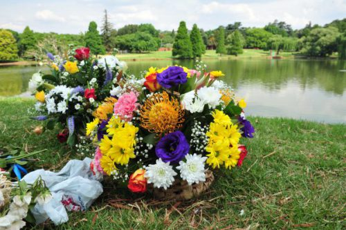 Flowers next to the dam in Rhodes Park in Kensington, 19 October 2015. Two men were murdered after being tied up and thrown into the dam over the weekend and one of the victims wifes was also raped during the incident.    File Picture: Neil McCartney