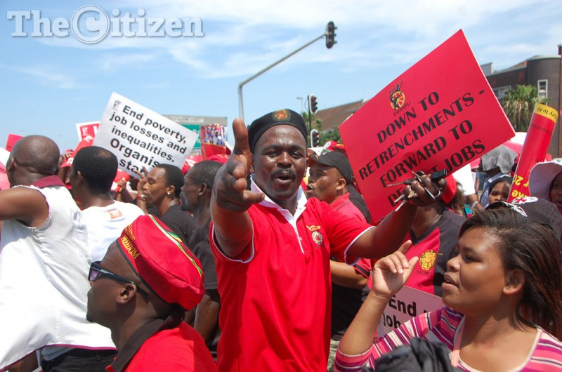 Members of the Congress of South African Trade Unions [COSATU] take part in a march from King Dinuzulu park, moved along the Pixley KaSeme Street and ended at the City Hall in Durban, in KwaZulu-Natal. The march was part of the nation wide marches which was organised by the union to raise concerns regarding socio economic challenges. Picture Phumlani Thabethe Date 07 October 2015