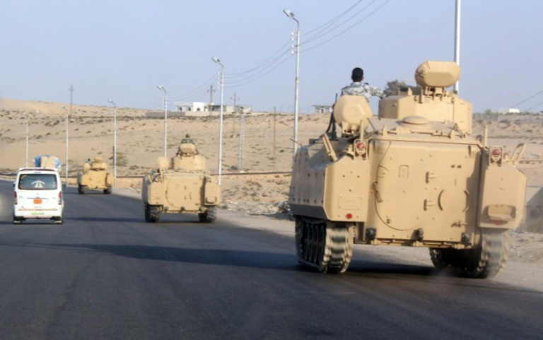 AFP/File / <br />A convoy of Egyptian armoured vehicles heads along a road in El-Arish on the Sinai Peninsula on August 13, 2011