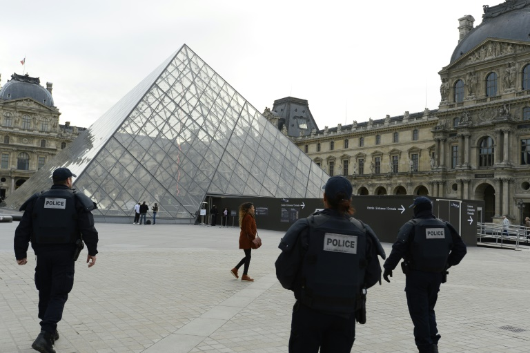 AFP/File / Bertrand Guay<br />Police patrol in front of the closed Louvre museum in Paris on November 14, 2015