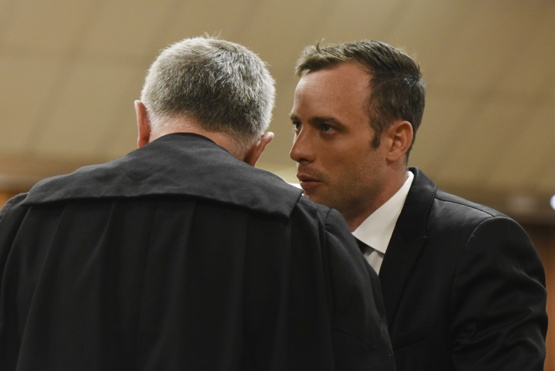 08 December 2015. Oscar Pistorius and Barry Roux before the start of proceedings. The hearing for the formal postponement of sentencing proceedings in the Oscar Pistorius matter will be at heard at the Gauteng Division of the High Court, Pretoria, on Tuesday 8 December 2015, in Court GD. Deputy Judge President of the Gauteng Division of the High Court, Judge Aubrey Ledwaba will be presiding. FOTO HERMAN VERWEY/POOL