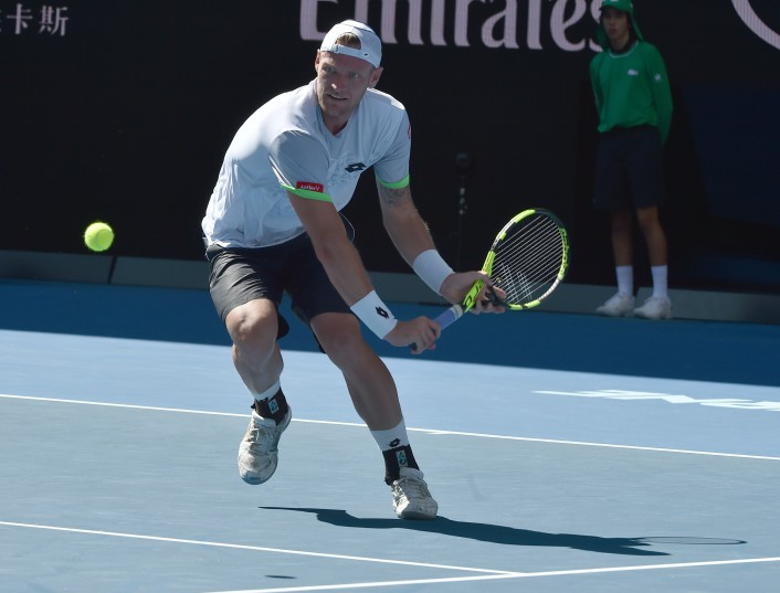 ustralia's Sam Groth plays a backhand return during his men's singles match against Britain's Andy Murray on day four of the 2016 Australian Open tennis tournament in Melbourne on January 21, 2016. AFP PHOTO / PAUL CROCK