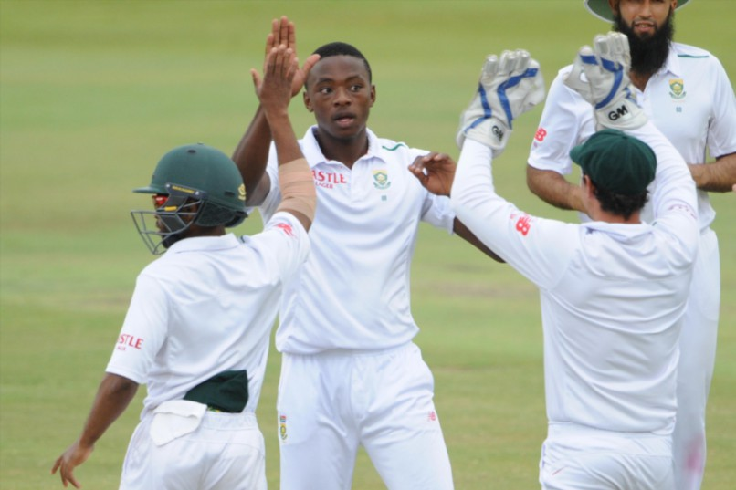 CENTURION, SOUTH AFRICA - JANUARY 25: Kagiso Rabada of the Proteas celebrates the wicket of Alex Hales of England with Temba Bavuma and Quinton de Kock of the Proteas during day 4 of the 4th Test match between South Africa and England at SuperSport Stadium on January 25, 2016 in Centurion, South Africa. (Photo by Lee Warren/Gallo Images)