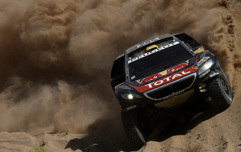 AFP/File / Franck Fife<br />Peugeot's driver Stephane Peterhansel and co-driver Jean Paul Cottret compete during Stage 9 of the 2016 Dakar Rally around Belen on January 12, 2016