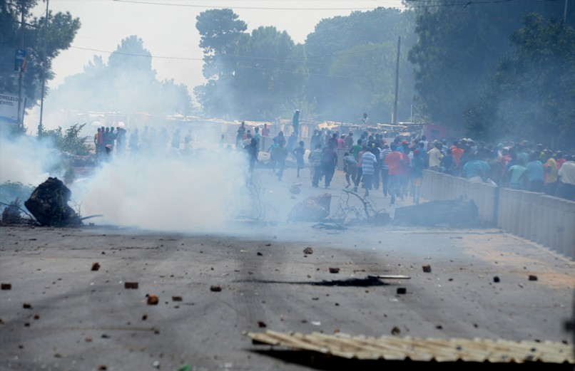 Protesters looted and barricaded roads during the Zandspruit informal settlement violent protests on March 16, 2016 in Johannesburg, South Africa. The protests were reportedly sparked by Eskom unexpectedly cutting connection in the area. (Photo by Gallo Images / Beeld / Denzil Maregele)
