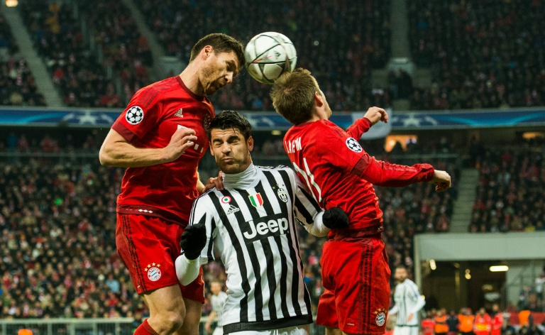 AFP / Odd Andersen<br />Bayern Munich's Xabi Alonso (L), Juventus' Mirko Vucinic (C) and Bayern Munich's Philipp Lahm go head to head during the match in Munich, on March 16, 2016