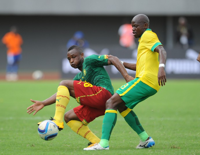 Hlompho Kekana of South Africa challenges Sebastien Siani of Cameroon  during the AFCON Qualifier match  between Cameroon and South Africa (Pic Sydney Mahlangu/ BackpagePix)
