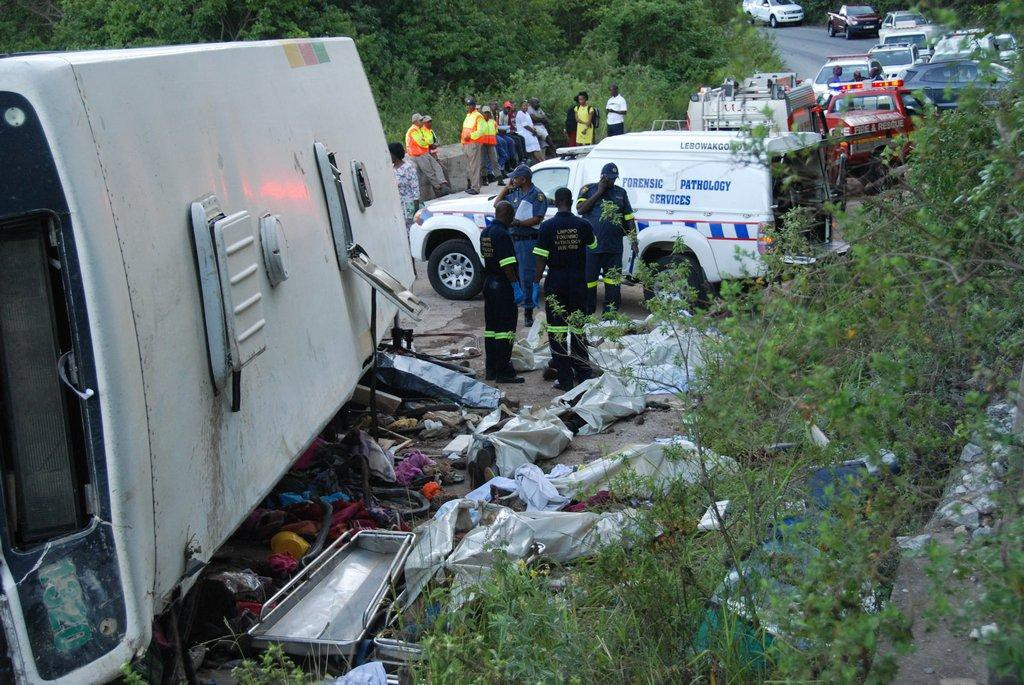 DEADLY:Pathologist marking corpses of ten members of Zion Christian Church were killed at Georgey valley on the R529 road between Moria Zion city and Tzaneen on Sunday between on the R529 Photo:Chester Makana