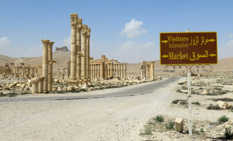 AFP / <br />A tourist sign at the ancient city of Palmyra, after government troops recaptured the UNESCO world heritage site from the Islamic State group
