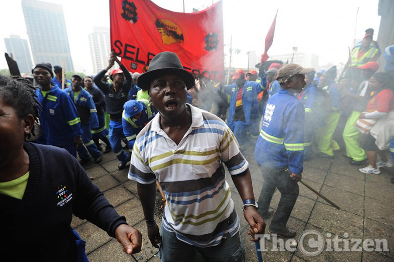 Pikitup workers affiliated to the SA Municipal Workers' Union gather outside the City of Johannesburg Council building, 9 March 2016, in Braamfontein, Johannesburg CBD,as they protest for higher wages. Picture: Alaister Russell