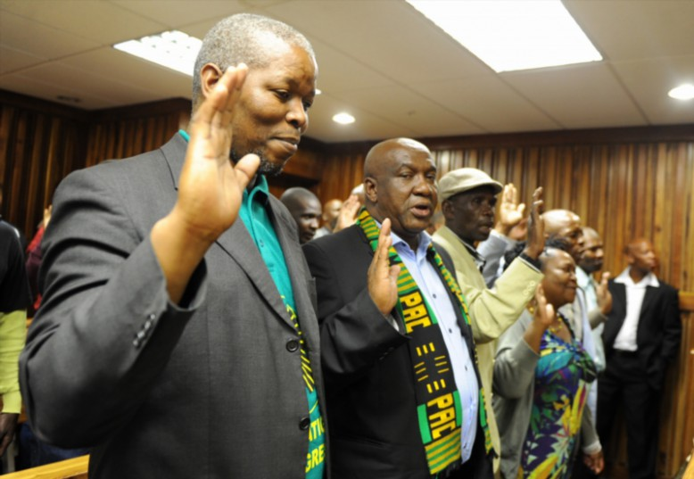 PAC President, Luthando Mbinda with other PAC members singing in court in support of Kenny Motsamai on February 5, 2016 at the South Gauteng High Court in Johannesburg, South Africa. Kenny Motsamai lost an application to force the Department of Correctional Services to release him on unconditional parole, stating that his parole conditions were unfair. (Photo by Gallo Images / Daily Sun / Jabu Kumalo)
