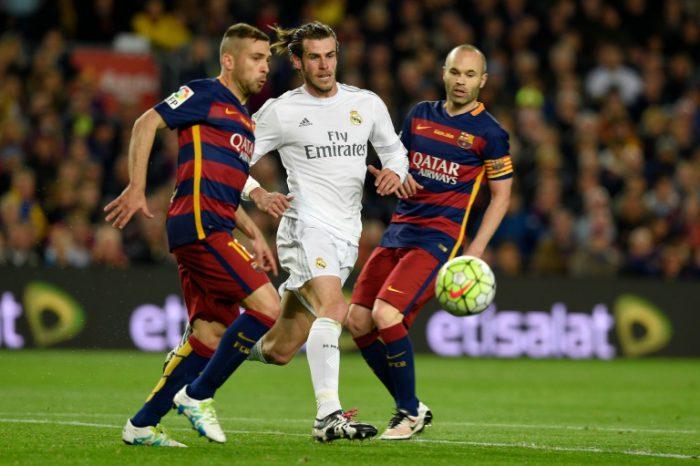 "AFP/File / Lluis Gene<br />Real Madrid's Welsh forward Gareth Bale (C) runs beween Barcelona midfielder Andres Iniesta (R) and defender Jordi Alba during the ""El Clasico"" in Barcelona on April 2, 2016"