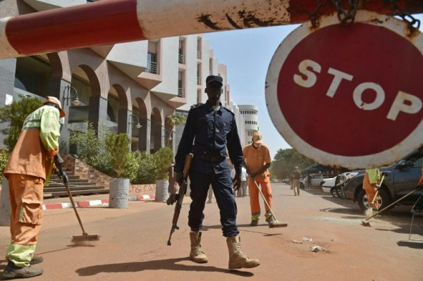 AFP/File / Issouf Sanogo<br />A Malian police officer stands guard as workers clean up ouside the Radisson Blu hotel in Bamako on November 22, 2015, two days after a deadly attack