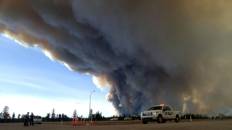 Alberta RCMP/AFP / RCMP Alberta<br />Members of the Royal Canadian Mounted Police monitor the fires around Fort McMurray in Alberta, Canada