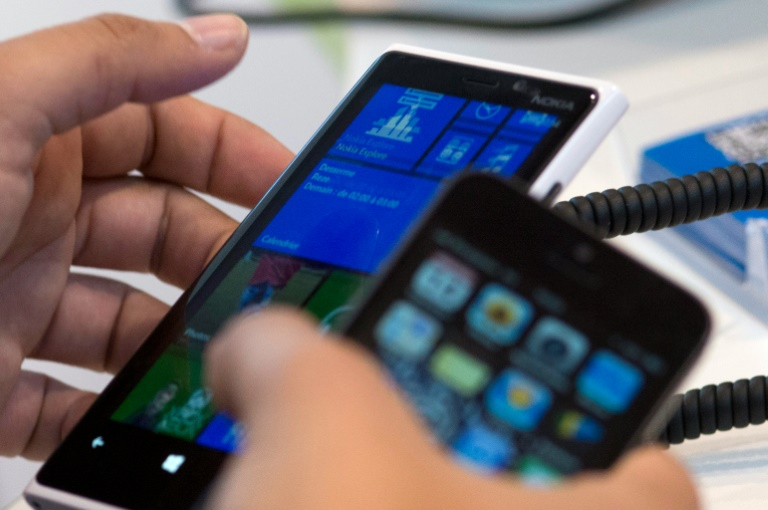 AFP/File / Fred Dufour<br />Nokia agreed to sell its mobile phone division to Microsoft for 5.4 billion euros in 2013